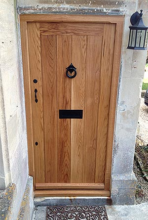 Oak door made by Neston Park Joinery